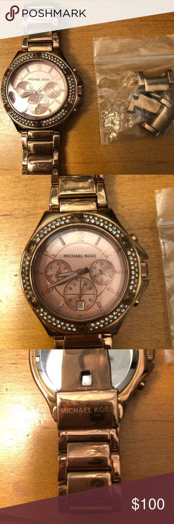 Michael Kors Rose Gold Rhinestone Watch Beautiful rose gold slightly oversized watch by Michael Kors with clear pavé rhinestone accents.   Approximately 38 mm face.   Great condition! Gently used with some minor scratches on wrist band from normal wear (pictured).   Some links have been removed but are included with pins for resizing. Battery will need to be replaced.  If you are interested or have any questions, please ask!  All reasonable offers welcome! 😊 Michael Kors Accessories Watches