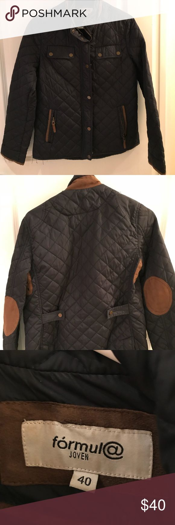 Navy/Tan Quilted Elbow Patch Jacket Size 10 Medium Navy quilted polyester jacket with cognac faux suede details. Perfect piece for a chilly fall day! Adjustable waist sizing with back clip features. Slight pulls along right sleeve and along bottom (pictured). Otherwise, jacket in great condition.   Measurements  Length- 24 inches Width- 20 inches  Arms- 23 inches Jackets & Coats Puffers