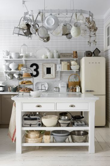 Scandinavian kitchen with open shelving - the large overhead pot hanger is