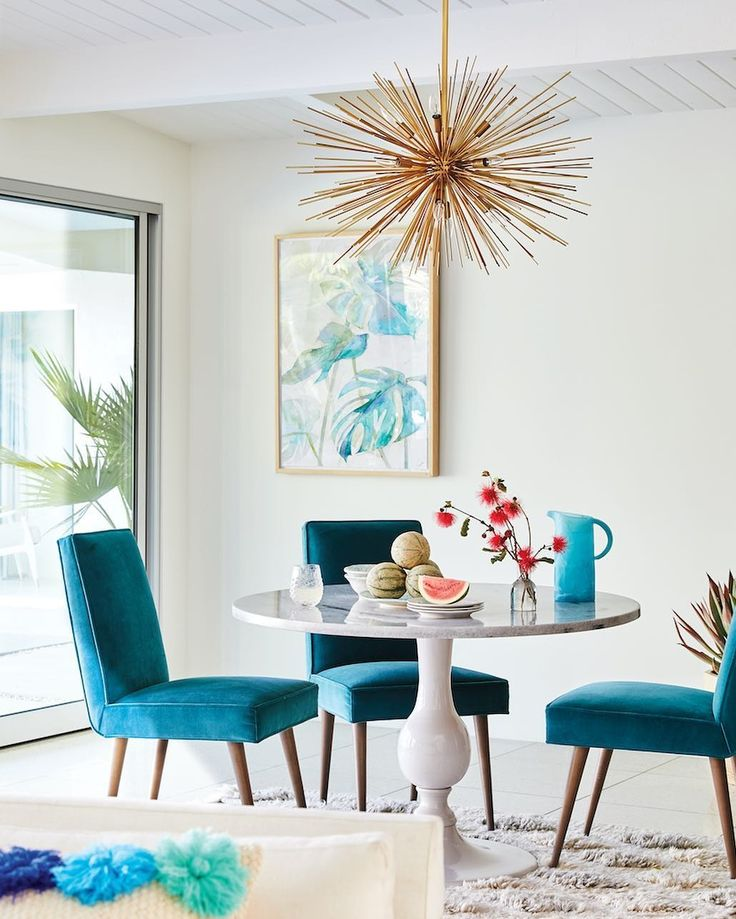 Teal dining room chairs and gold light fixture - colorful and happy decor