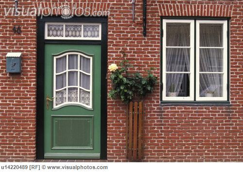 colored doors on red brick houses - Google Search