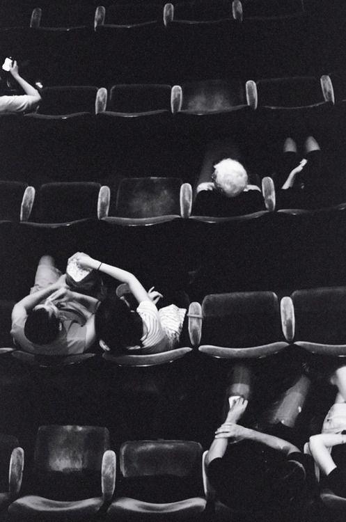 """C'est un film qui est sur les écrans à l'heure actuelle"""" - it's playing now in theaters (""""le cinéma"""" is ONLY for movies, """"le théâtre"""" is only for plays - """"une pièce de théâtre"""")"""