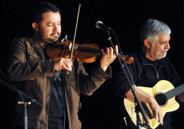 Daniel Cantillana (left) and Jorge Coulon play as part of Inti-Illimani, a Chilean folk ensemble, at Easton Area Middle School on Tuesday.