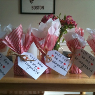 Little split champagne bottles and hand stamped cards to ask your girls! :)