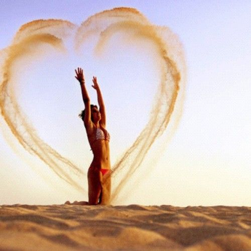 Cute beach photo idea. I would never ever be able to do this and it not end in sand in the eyes..