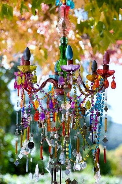 "Bohemian chandelier - start with a thrifted chandelier and add bits and bobs until it sings! ~~ **Note** clear glass & crystals can be ""stained"" with glass paint or even nail polish* Love this idea for Mardi Gras-to hang on porch"