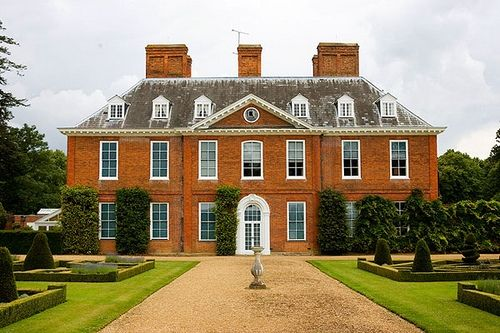 Squerryes Court, an early Georgian style country house in Kent, was the home of the de Squerie family in the 13th century, after which it had many different owners; John Warde bought the property in 1731, and his descendants still live there [1]. The present house dates from the late 17th century, although it has undergone much remodeling and restoration since then [2]. Squerryes Court represented Hartfield in the 2009 verison of Emma