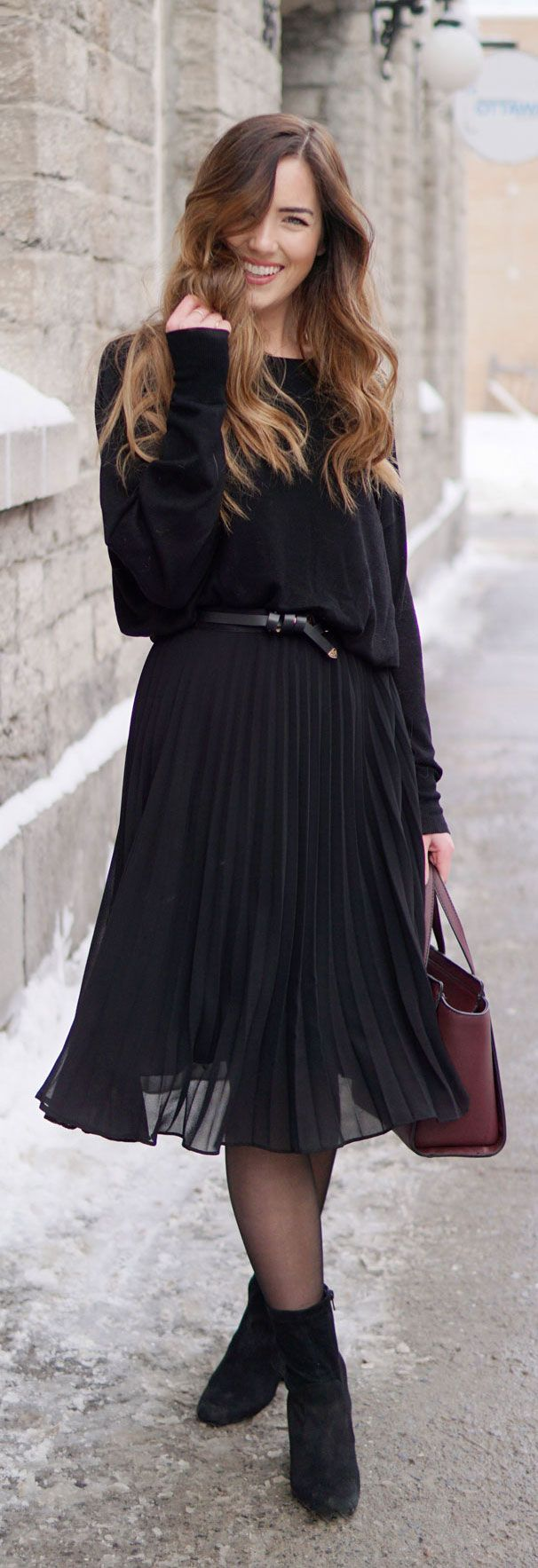PLEATED BLACK MIDI SKIRT on sale for under $30 - unexpected way to wear a feminine skirt: slouchy black sweater and sock booties - all on sale!! #fashion #winter #black #fashionblog Marie's Bazaar