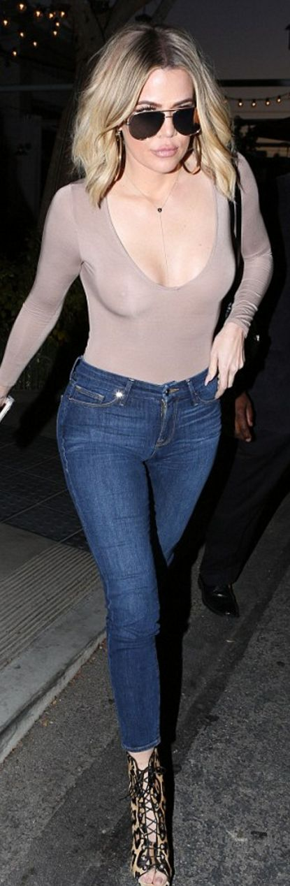 Khloe Kardashian in Jeans – Good American  Shirt – Naked Wardrobe  Necklace – Monica Rose  Sunglasses – Quay