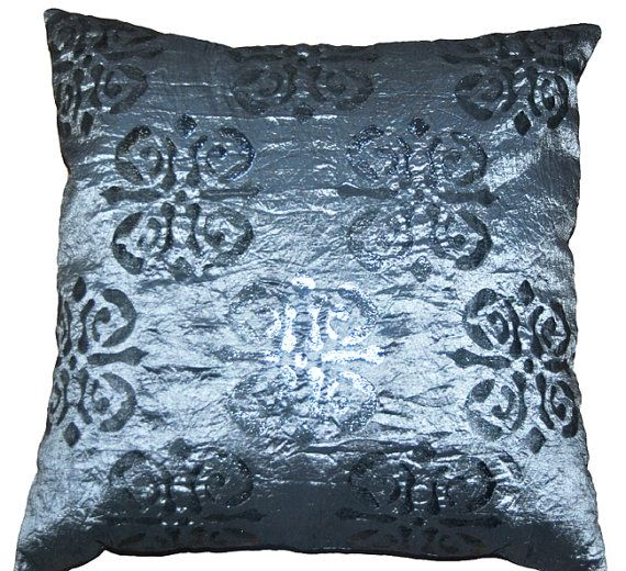 The patterns on the pillows were laser cut by halletextiledesign