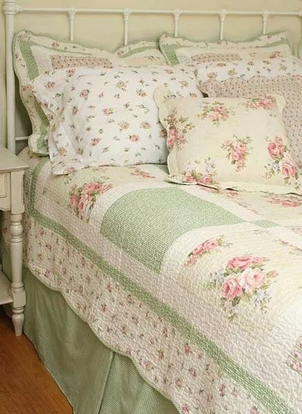 Sammy loves this, especially the colors. Shabby chic sage green and pink bedspread.