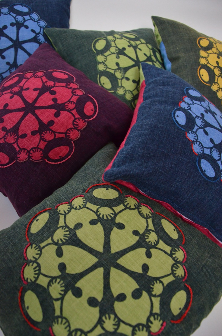 Handprinted and embroided pillows.  By Tina Olsson