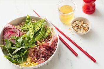 Salami and brown rice salad bowl