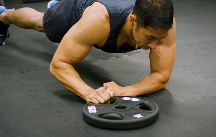 Tweak the tried-and-true plank to get your summer six-pack