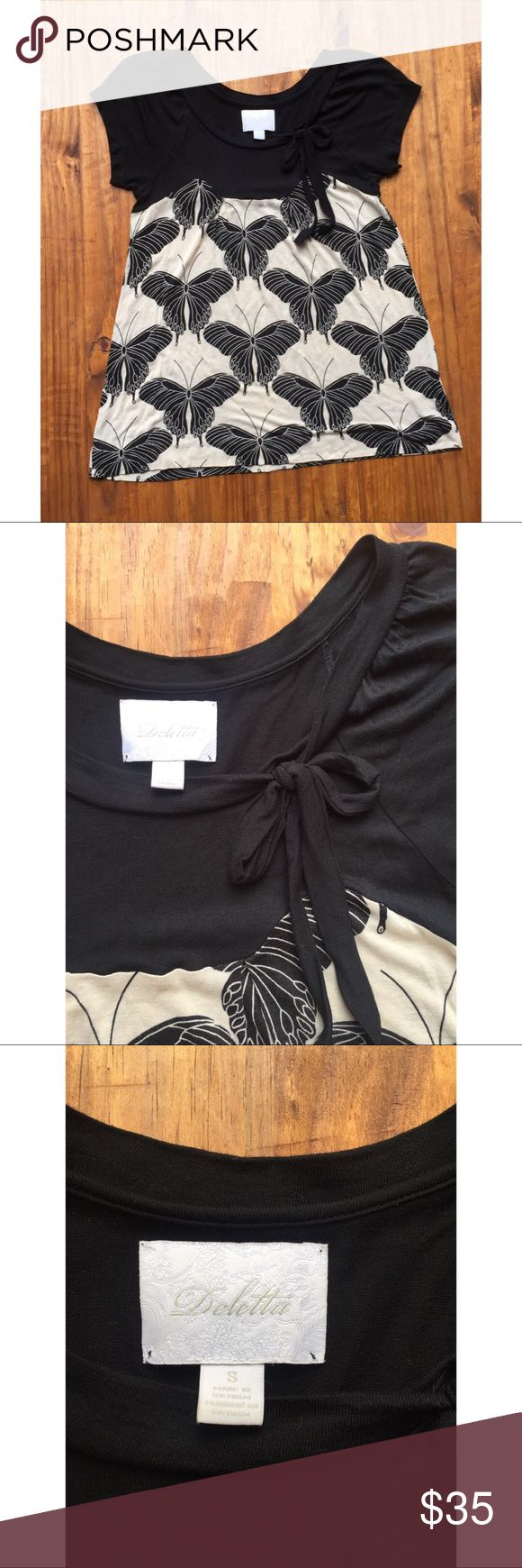 🦋Deletta Butterfly Black and Nude Cap Sleeve Top This perfect Anthropologie top will look so great on that perfect lady, or that perfect grade school teacher during whose children would love to see this shirt! Excellent Used Condition. No pilling, stains, or rips. Offers Welcome! Anthropologie Tops Tees - Short Sleeve
