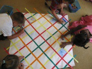 The children made group quilts for our continuing celebration of the Indiana State Fair. As I walked into this classroom, I observed the children all gathered around something, so I had to take a closer look to see what all the hub-bub was about.