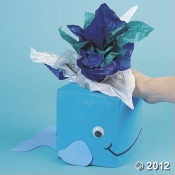 Take an old (square) tissue box, paint it blue, add a tail/fins'eyes/smile, and tissue paper= a cute tabletop whale :)