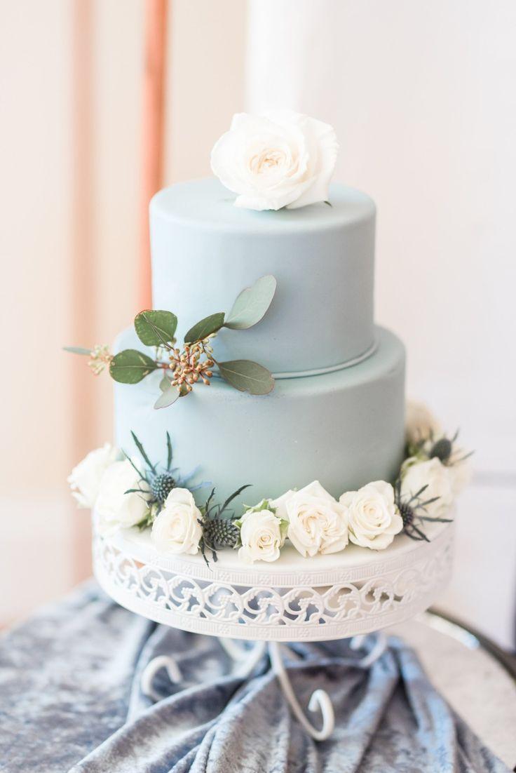 Blue wedding cake on white wedding cake