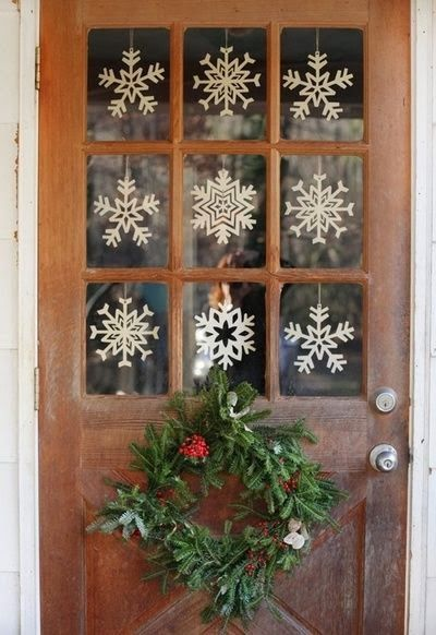Use snowflake decals or hanging cut-outs to fill each open glass pane on your front door.