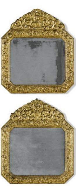 A pair of Anglo-Dutch gilt embossed copper and walnut easel mirrors late 17th century