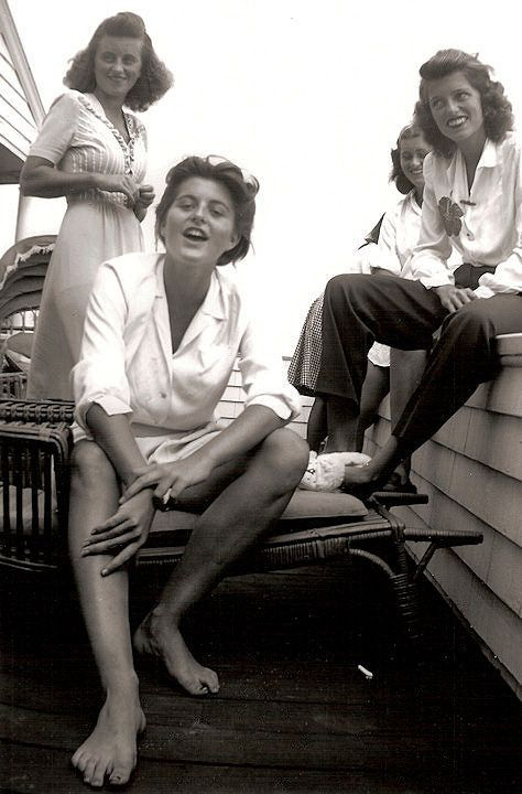 U.S. A candid snapshot of the Kennedy girls on the porch at Hyannis Port. Left to right - Kathleen, Pat, Eunice, Jean. September 1944.