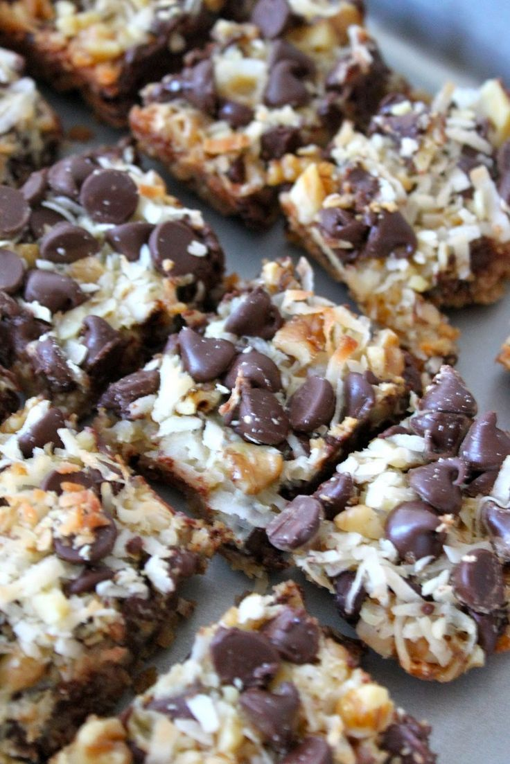 1/2 cup butter, melted 1 1/2 cup graham cracker crumbs 1 (14 ounce) can Eagle Brand Sweetened Condensed Milk 2 cups semisweet chocolate chops 1 1/3 cups flaked coconut 1 cup chopped nuts, Preheat over to 350 degrees Fahrenheit. Coat 9x13 baking pan with no-stick cooking spray. Combine the graham cracker crumbs and butter. Press into bottom of prepared pan. Pour sweetened condensed milk evenly over crumb mixture. Layer with chocolate chips, coconut, and nuts. Press firmly down with