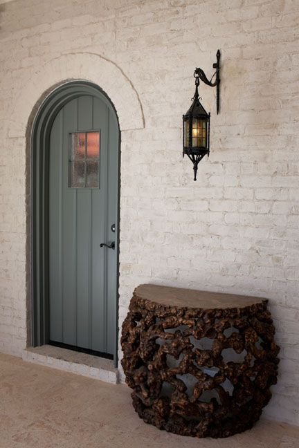 Limewashing a brick exterior can yield surprising and beautifully paint-like results. Lime is porous and allows the brick to breathe, unlike paint, so it is long lasting, but it does eventually age.