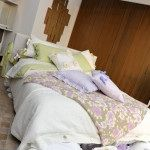 IRENE BI  Copripiumone in tessuto di lino con bottoni in madreperla www.irenebi.it realizzazione Irene Bi di Irene Brigolin