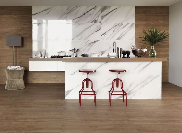 A mix of wood tiles and white marble tile panels lift this kitchen to something extra special