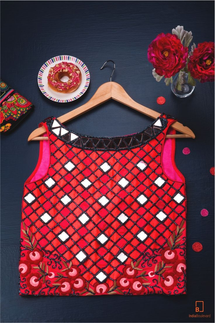 A red tank that is custom designed with diamond shaped mirrors. It has a breezy…