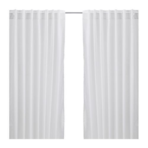 VIVAN Curtains, 1 pair IKEA The curtains let the light through but provide privacy so they are perfect to use in a layered window solution.