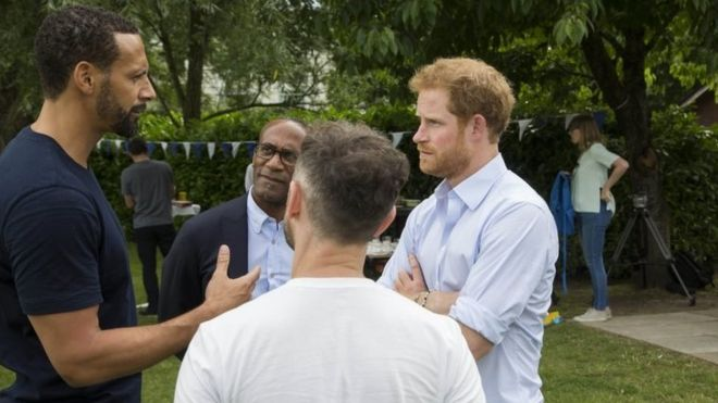 Handout photo issued by the Royal Foundation of (left to right) Rio Ferdinand, Julian Ferdinand (Rio's father), Prince Harry and Ben Brooks Dutton at the Heads Together barbecue at Kensington Palace in London