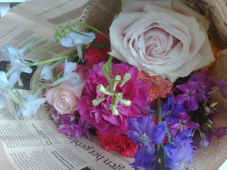 Summerflowers giftwrapped in a newspaper