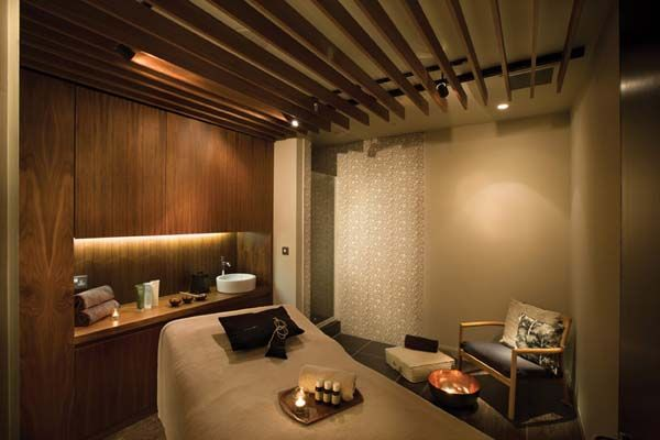 I like the zen feel of this space.  the slatted ceiling feature the texture on a portion of the wall.  No art needed with a wall feature like that.