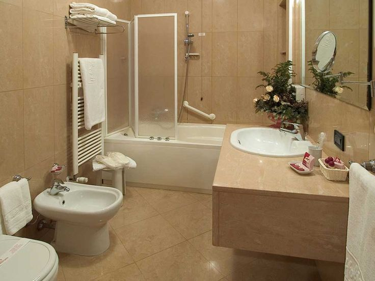 Small Modern Bathroom Design Ideas with brown ceramic floor and wall