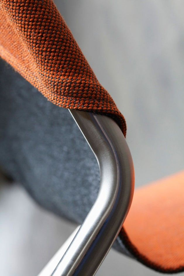 The reversible chair, two pieces of fabric sewn together to make a garment, this makes it instantly multi-functional as a two of the same garment in different colours.