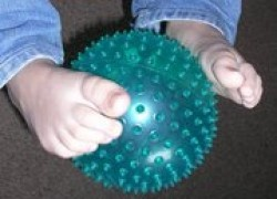 Ball pass is a fun game where children only use their feet. Using differently textured balls makes it a great sensory activity as well. Great core workout.