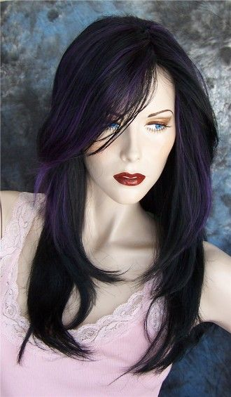Purple and black hair, pale skin, red lipstick. I have a feeling this might be me in 15 years