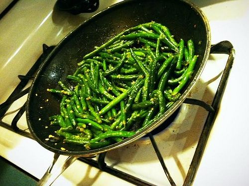 Pan-cooked green beans. Buy some steam-in-the-bag green beans; that makes sauteing them in the pan after you steam them a much quicker process. We saute ours with butter, salt and pepper, and minced garlic, and often top them with Parmesan cheese or fresh squeezed lemon juice, toss some sliced mushrooms in there for even more flavor.