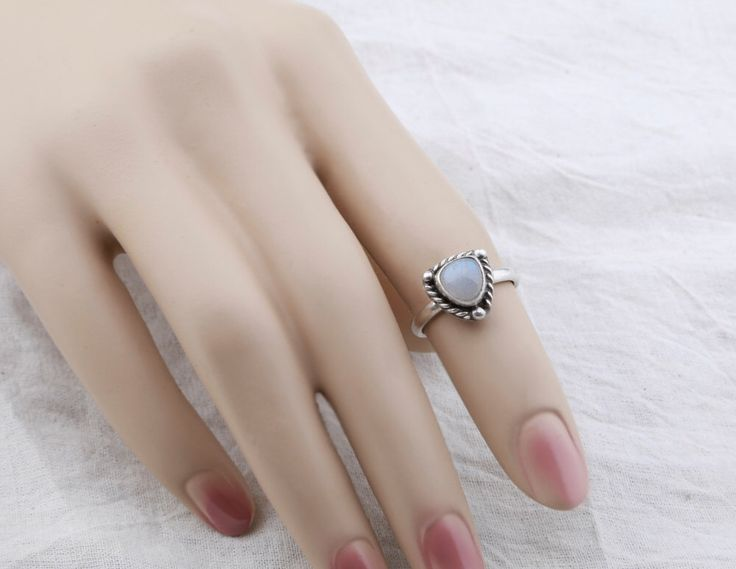 Dainty Rainbow Moonstone Sterling Ring. Moonstone jewelry - US Size 6 by AtThursday on Etsy https://www.etsy.com/listing/215607097/dainty-rainbow-moonstone-sterling-ring