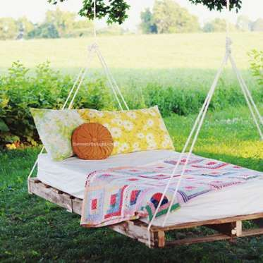 Hang up this DIY pallet-and-rope swing bed from Manda at The Merrythought on a sturdy tree branch fo... - Courtesy of Tree-Swing Bed