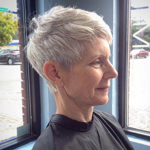 To create depth, odd darker color to roots, for thickness...Older Women's Gray Pixie Hairstyle