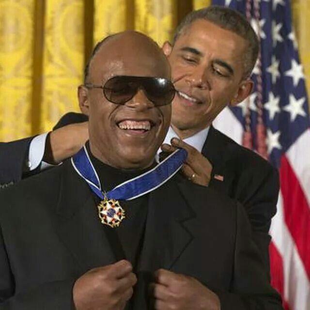 Stevie Wonder receives a Presidential Medal of Freedom from President Barack Obama (2014)