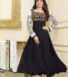 Now doesn't this black salwar suit make you wanna own it?!! Black and white embroidered georgette semi stitched salwar with dupatta
