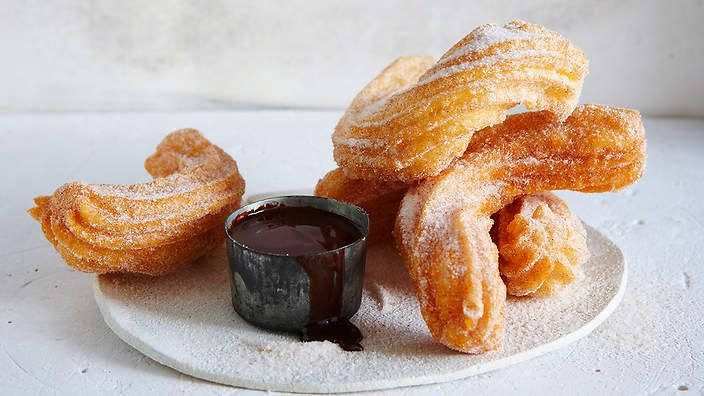 Cinnamon sugar churros with a bitter sweet chocolate sauce from the food dept. (recipe by Sally Courtney, photography by Petrina Tinslay, styling by David Morgan and art direction by Anne Marie Cummins).