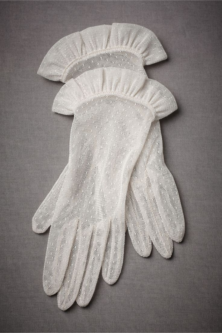 """Victoriana Gloves Sheer point d'esprit tulle is cut and sewn into a demurely ruffled pair, reminiscent of the grace of the nineteenth century. From Carolina Amato. 10""""L. Polyester. Spot clean. Imported."""