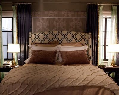 Carrie & Big's Apt:  shot of their bed- with a cool modern headboard in Velvet Gate Tuxedo from Kravet and of course, lots of pillows with bedding from Anichini