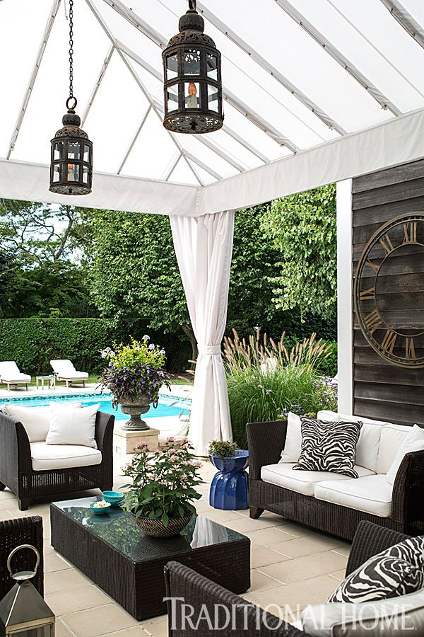 Moroccan-made iron lanterns replace predictable nautical lanterns in the tented poolside pavilion. - Photo: John Bessler / Design: Young Huh