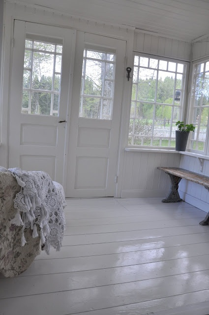 love the white floors and bright windows.