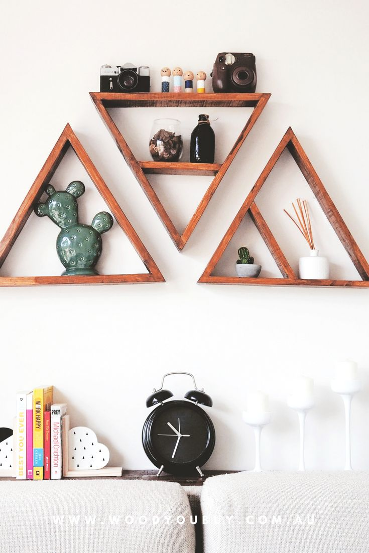 A beautiful way to style your living room with these triangle rustic shelves. A great home decor! #shelf #rusticshelves #homedecor